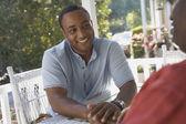 African American man sitting on porch — Fotografia Stock