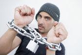 Hispanic man with chains around wrists — Stock Photo