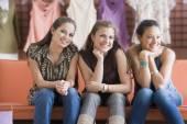 Multi-ethnic teenaged girls at clothing store — Stock Photo