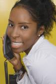 African woman talking on telephone — Stock Photo