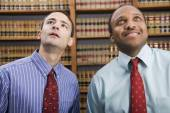 Multi-ethnic businessmen looking up — Stock Photo
