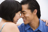 Asian couple smiling at each other — Stock Photo