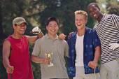 Multi-ethnic men with golf trophy — Stock Photo