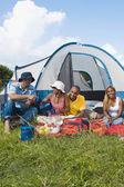 Multi-ethnic friends camping — Stock Photo
