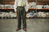 African male sales clerk in flooring warehouse — Stock Photo