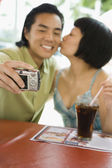 Asian couple taking own photograph — Stock Photo