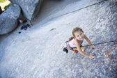 Asian girl rock climbing — Stock Photo