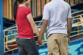 Multi-ethnic teenaged couple holding hands — Stock Photo