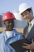 Multi-ethnic businessman and construction worker — Stock Photo