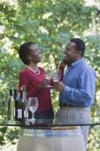 African couple drinking wine — Stock Photo