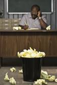 Senior African American male worker writing at desk — Stock Photo