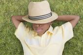 African American boy laying in grass — Stock Photo