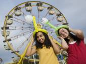 Multi-ethnic teenaged girls at carnival — Stock Photo