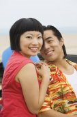 Asian couple hugging — Stock Photo