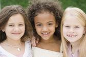 Multi-ethnic girls smiling — Stock Photo