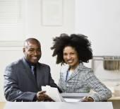 Businesspeople holding folder — Stock Photo