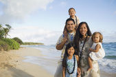 Pacific Islander family at beach — Stock Photo