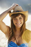 Smiling woman in straw cowboy hat — Stock Photo