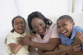 African American mother and children laughing — Stock Photo
