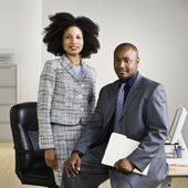 Businesspeople in front of desk — Stock Photo