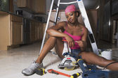African woman on floor with power tools — Foto Stock