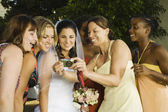Hispanic bride and friends looking at camera — Stock Photo