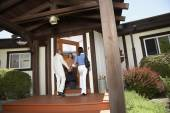African American couple entering house — Stock Photo