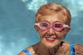 Senior woman in swimming pool — Stock Photo