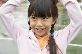 Asian girl with hands on head — Stock Photo