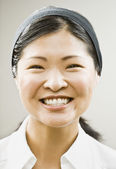 Asian woman wearing headband — Stock Photo