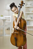 Mixed Race girl holding cello — Stock Photo