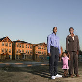 African American family at residential construction site — Stock Photo