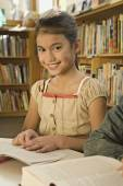Pacific Islander girl in library — Stock Photo