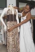 African woman adjusting dress — Stock Photo