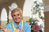 Senior woman wearing party hat — Stock Photo