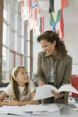 Teacher helping student with homework — Stock Photo