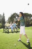 Asian woman playing golf — Stock Photo
