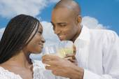 African couple drinking wine — Stock Photo