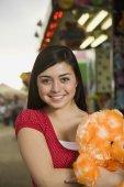 Mixed Race teenaged girl at carnival — Stock Photo