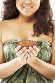 Pacific Islander woman holding bath salts — Stock Photo