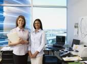 Multi-ethnic businesswomen in office — Stock Photo