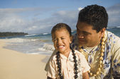 Pacific Islander father and son at beach — Stock Photo