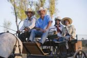 Hispanic family in horse-drawn carriage — Stock Photo