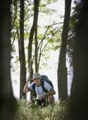Mixed Race man in woods — Stock Photo