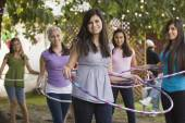 Hispanic girls playing with hula hoops — Stock Photo