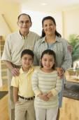 Hispanic grandparents and grandchildren — Stock Photo