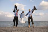 African businesspeople cheering at beach — Stock Photo