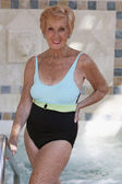 Senior woman wearing bathing suit — Foto Stock