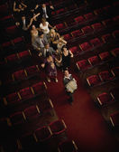 Hispanic people dancing in theatre aisle — Stock Photo