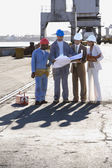 Multi-ethnic businesspeople and construction workers — Stock Photo